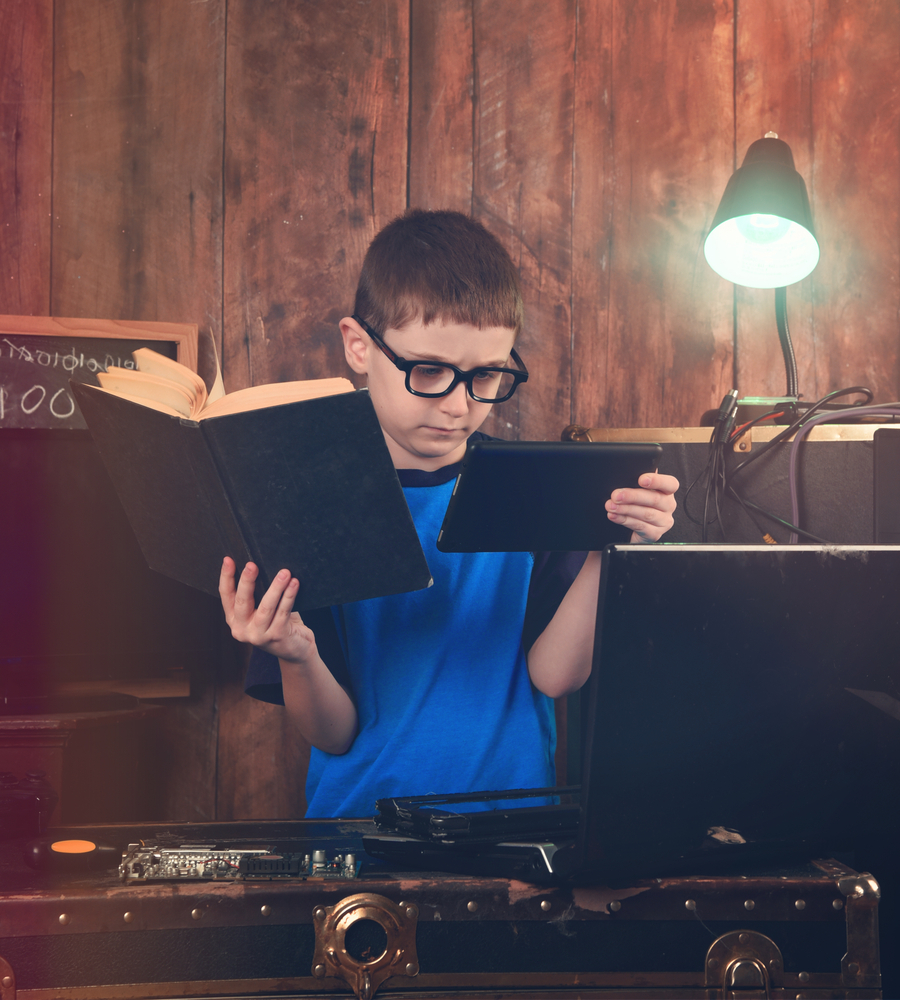 boy choosing to view video rather than the book